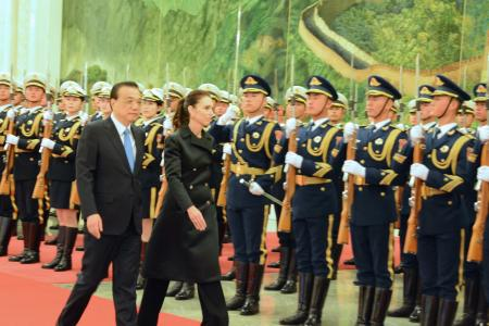 Premier Li Keqiang and PM Jacinda Ardern inspect the People's LIberation Army Honour Guard at Beijing's Grand Hall of the People yesterday